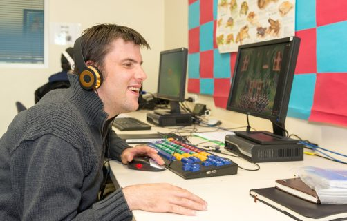 Young man participating in computer learning lesson at OC Connections Oakleigh