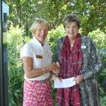 therese desmond oc ceo accepts donation from metropolitan golf course